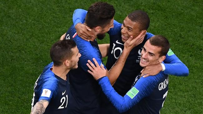 France's forward Kylian Mbappe (2nd R) celebrates his goal with teammates during the Russia 2018 World Cup match between France and Peru.