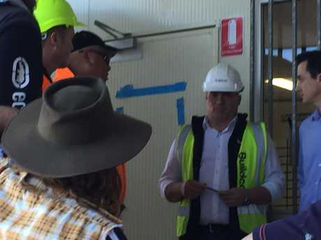 Protesters on the Australian Catholic University site in Brisbane with subcontractors confront Buildcorp site manager Julian Woodward following the collapse of Sunshine Coast contractor Ideal Interior Linings.