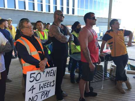 Angry subbies at a protest on a Brisbane building site this morning.