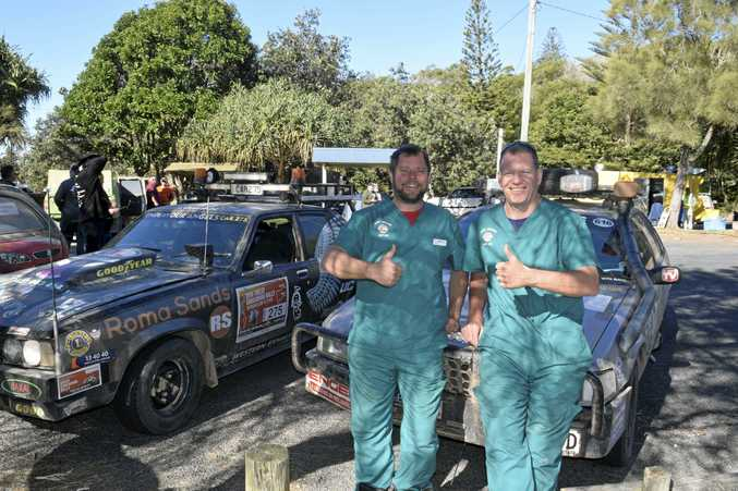 THUMBS UP: The Dirty Doctors, otherwise known as Nigel Lomas and Peter Brady, at the finish line of the Great Endeavour Rally in Yamba.