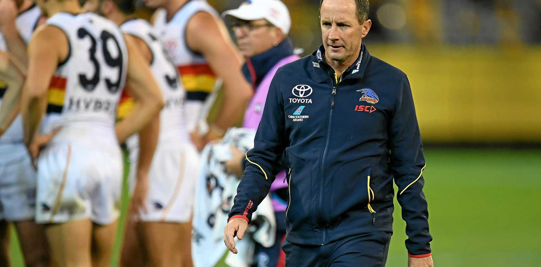 Crows coach Don Pyke does not look a happy man after addressing his players during their diastrous loss to Hawthorn on June 16.