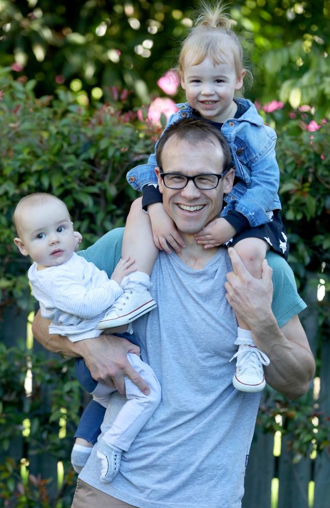 Paul Mills with son Lawson and daughter Florence. He took three weeks off when his daughter Florence was born and took a further 15 weeks when she was seven months. Picture: Bruce Long