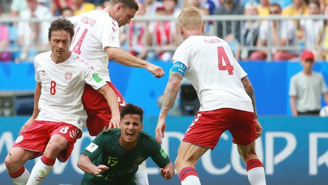 The Socceroos' Daniel Arzani is tackled by Denmark's Thomas Delaney and Henrik Dalsgaard at Russia's Samara Arena. Picture: Toby Zerna