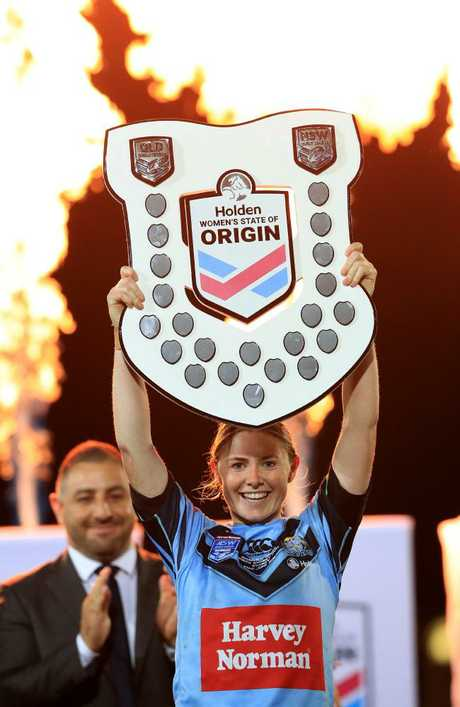 Captain Studdon with the shield. Picture: Adam Head