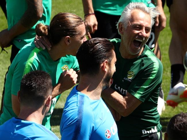 Bert van Marwijk, right, shares a moment of mirth with Jackson Irvine. Picture: Getty Images