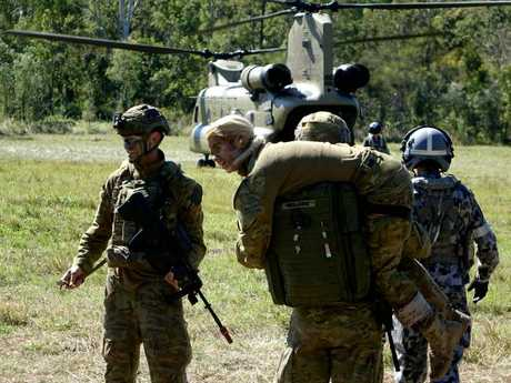 Casualties are carried to an awaiting helicopter. Picture: Major Al Green