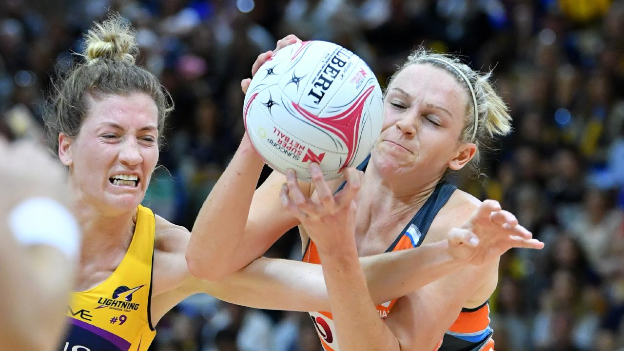 Giants star Joanne Harten (right) clashes with the Lightning's Karla Pretorius. Picture: AAP