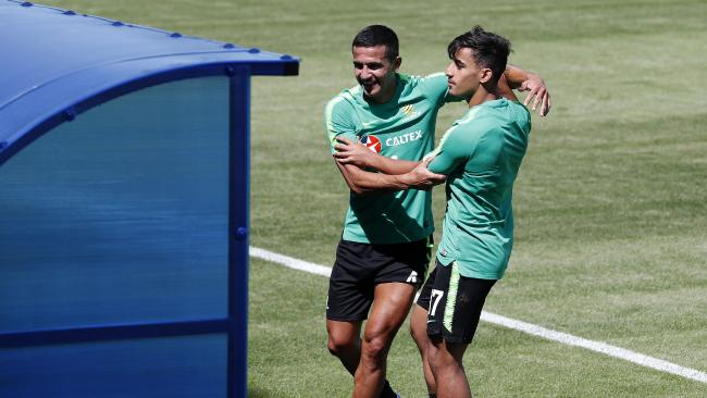 Tim Cahill and Daniel Arzani have grown closer during the World Cup under coach Bert van Marwijk. Picture: Toby Zerna