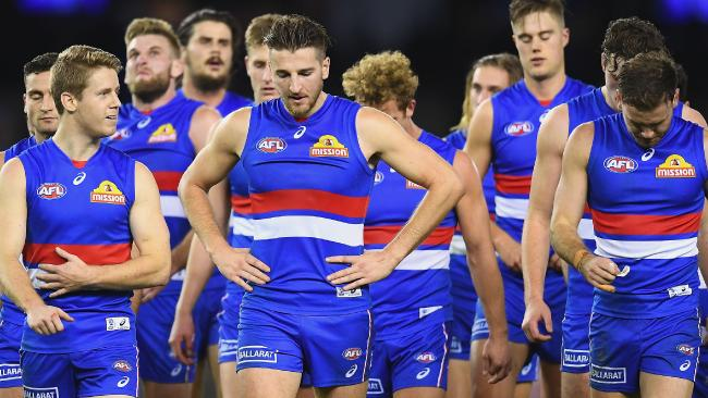 Bulldogs players walk off Etihad Stadium after their loss. Picture: Getty Images