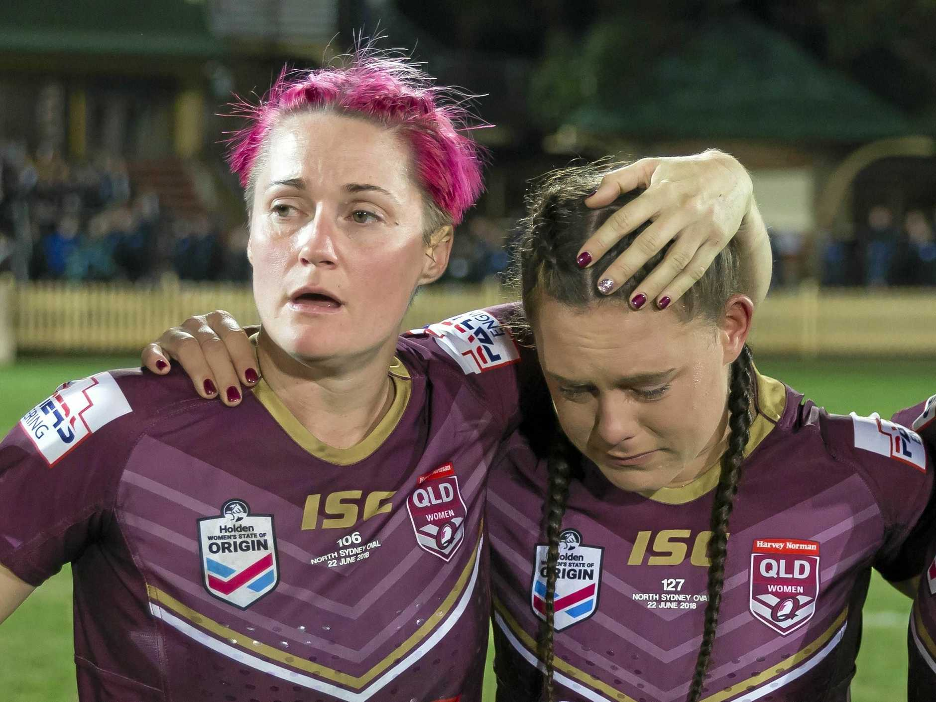 Chelsea Baker (left) consoles Mariah Storch after Queensland's 16-10 defeat.