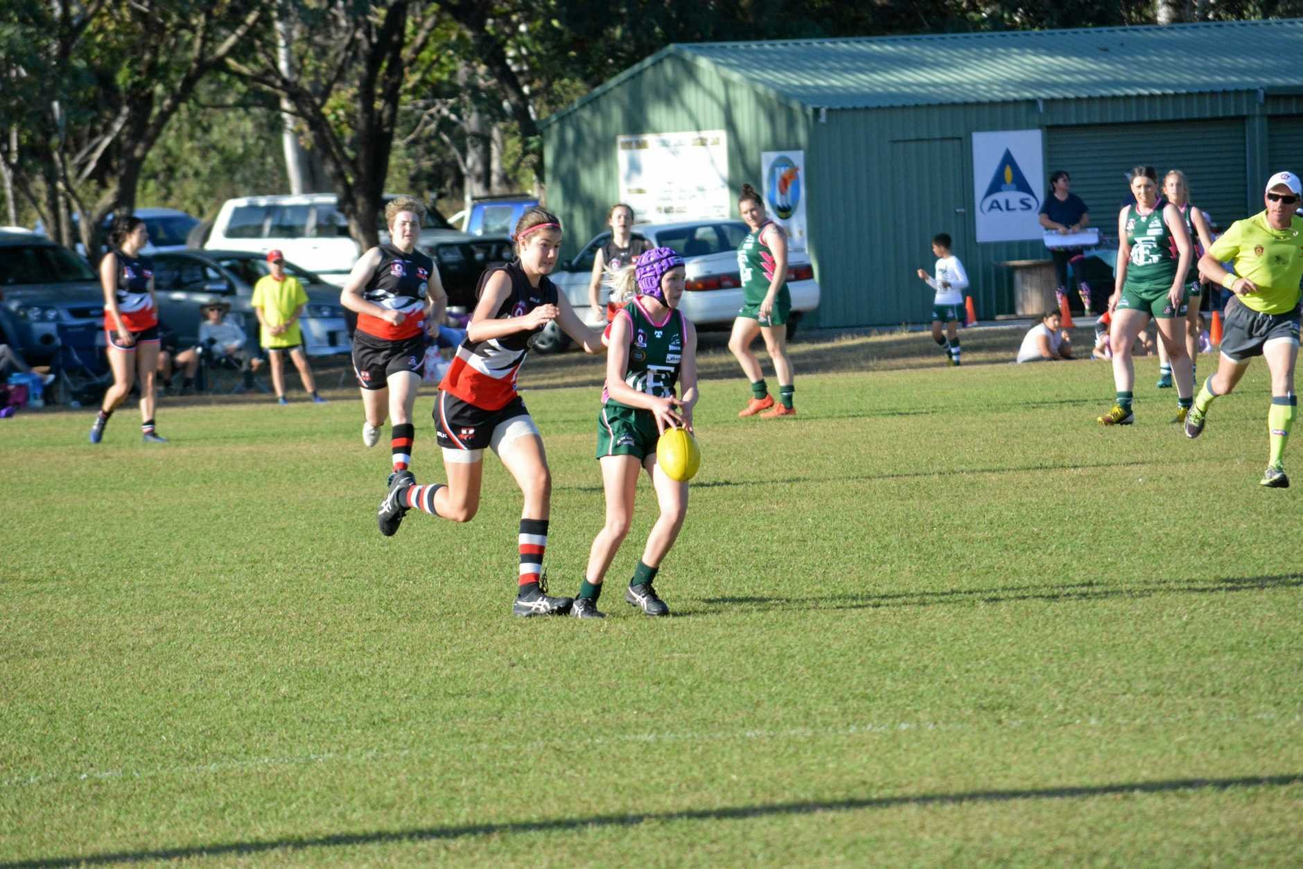 FIRED UP: BITS' Sophie Ure chases Emily Kirkwood.