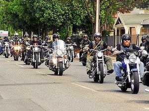 Police swoop on Rebels gang in Rockhampton