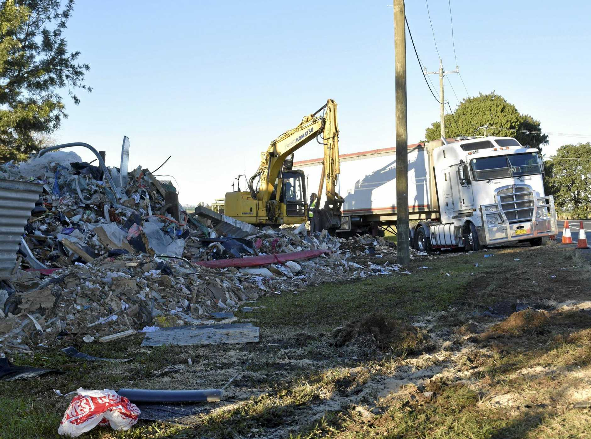 ROADSIDE CARNAGE: The aftermath of last week's crash where a B-double truck came within metres of a family home.