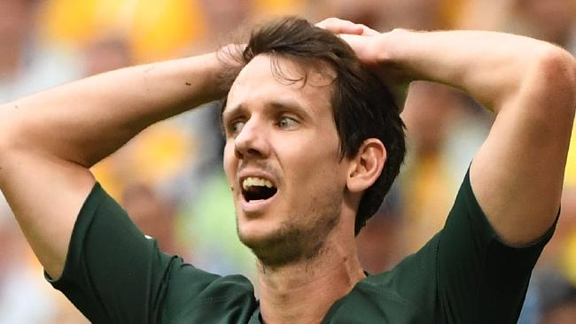 Australia's Robbie Kruse during their FIFA reacts after a missed opportunity against Denmark at Samara Arena during the FIFA 2018 World Cup in Samara, Russia, Thursday, June 21, 2018. (AAP Image/Dean Lewins) NO ARCHIVING