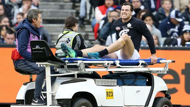 Lachie Plowman is stretchered from the ground. Picture: Michael Klein