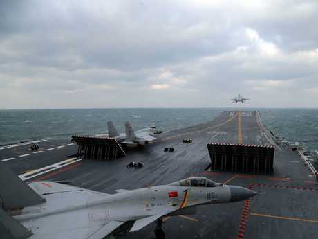Chinese J-15 fighter jets being launched from the deck of the Liaoning aircraft carrier during military drills in the Yellow Sea, off China's east coast. Picture: Xinhua