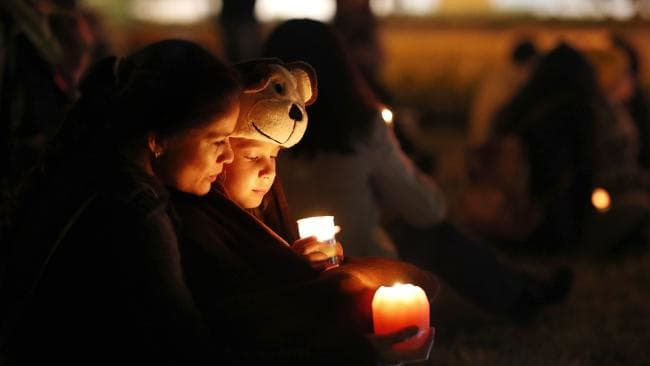 Claudia and Ella Yakubchak at a candlelight vigil held at the shopping centre the night of the accident. Picture: AAP/Josh Woning
