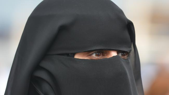 Women in Dubai will often cover their faces if they are too beautiful. Picture: Getty.