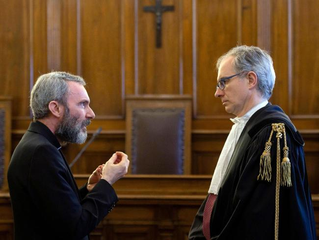 Former Holy See diplomat Monsignor Carlo Alberto Capella (L) talks to his lawyer Roberto Borgogno inside a Vatican tribunal courtroom during his trial. Picture: AP