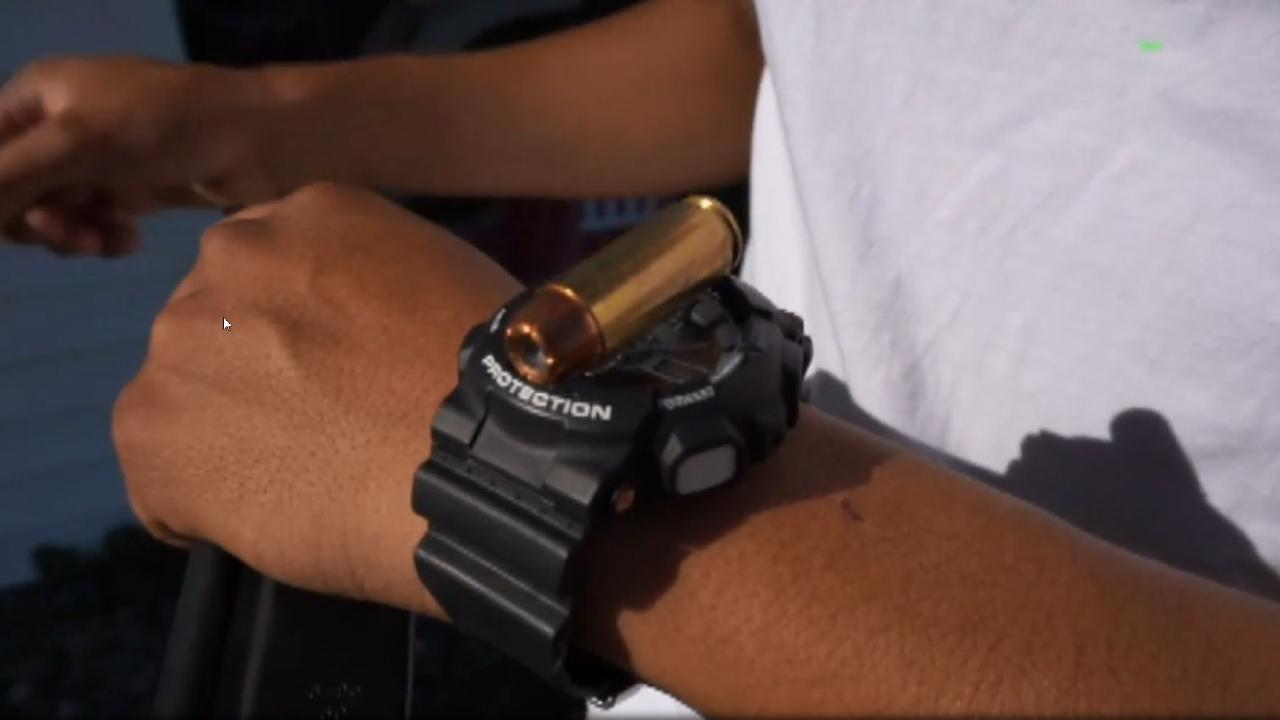 Mr Ruiz compares the size of the bullet to his watch for scale.