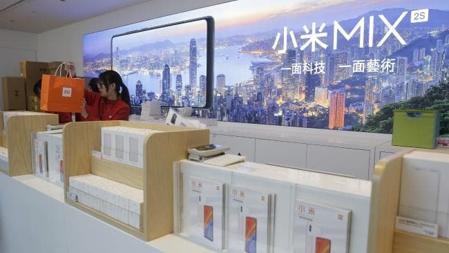 A shop assistant works at a counter in a Xiaomi store in Hong Kong. Picture: Kin Cheung