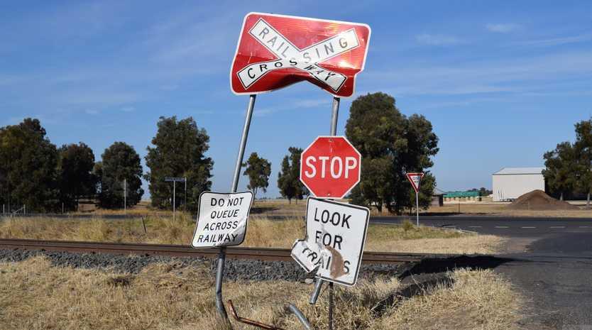 Damaged signs by the railway crossing on Dawson's Gate Rd, Chinchilla near the Warrego Highway.