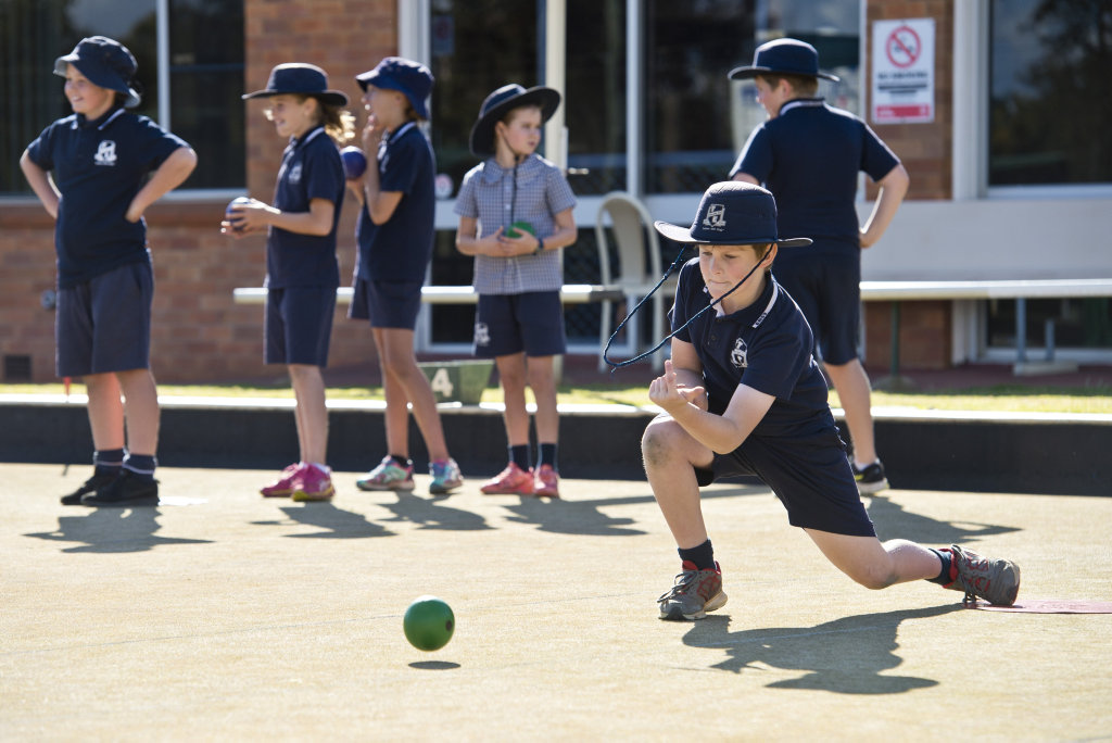 Zachary Smith sends down a shot as Toowoomba Bowls Club host students of Toowoomba East State School, Monday, June 25, 2018.