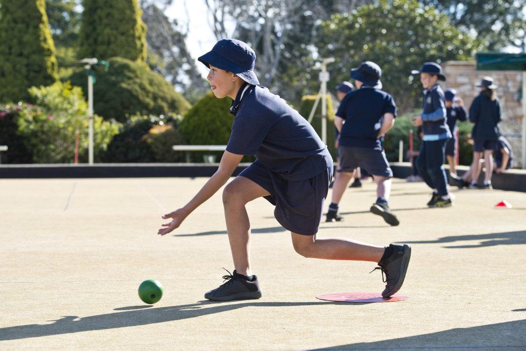 Elliott Tupas bowls as Toowoomba Bowls Club host students of Toowoomba East State School, Monday, June 25, 2018.
