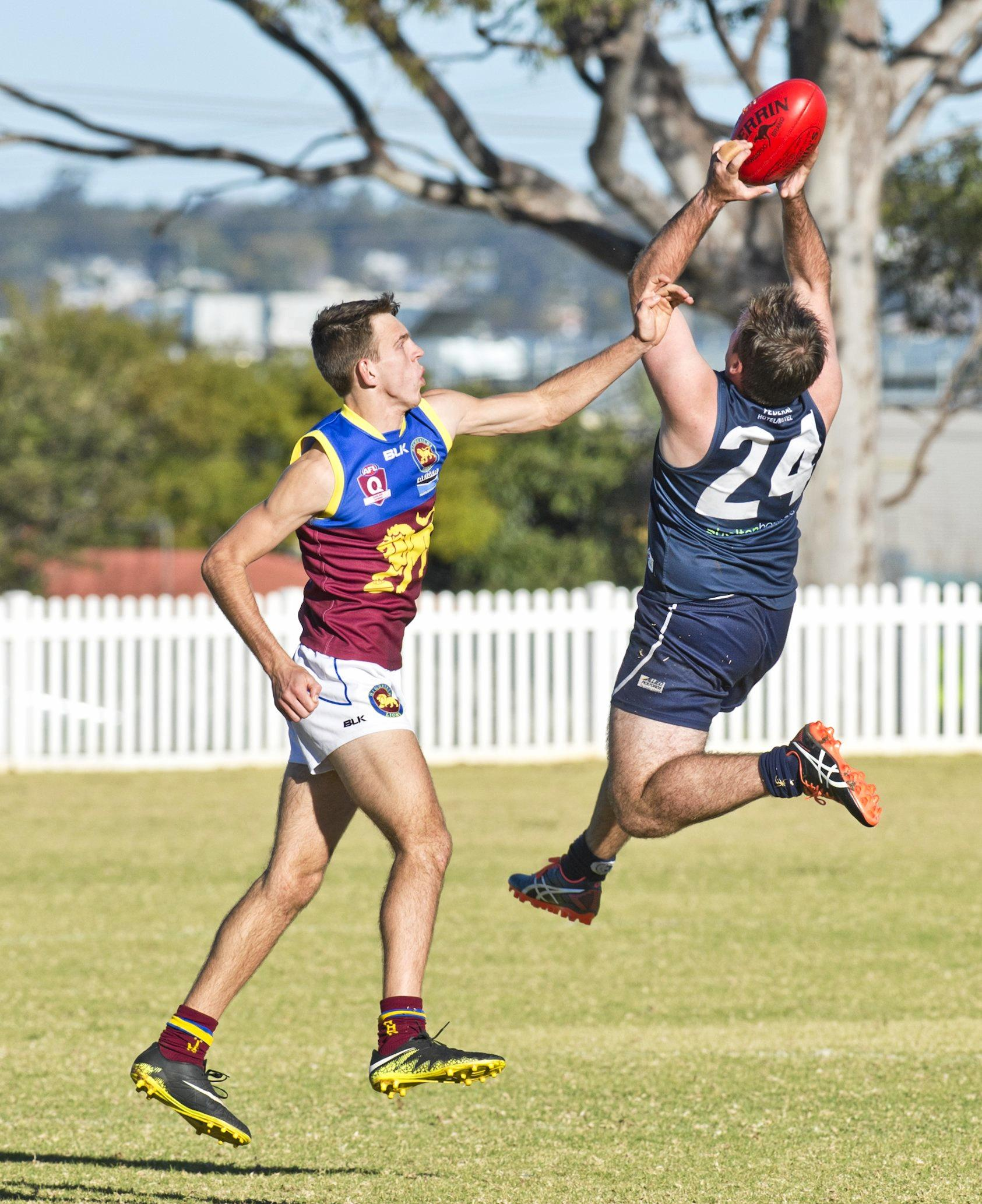 EYES UP: Thomas Claydon takes a mark for Coolaroo against Highfields.