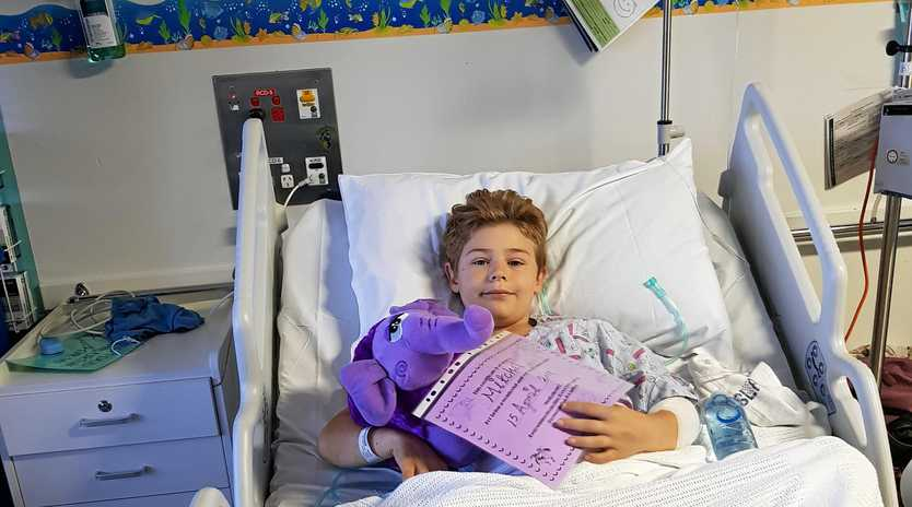 BRAVE BOY: Mitch, 9, is recovering in the Lady Cilento Hospital in Brisbane after his right foot was ripped from the bone in a horrific farming accident.