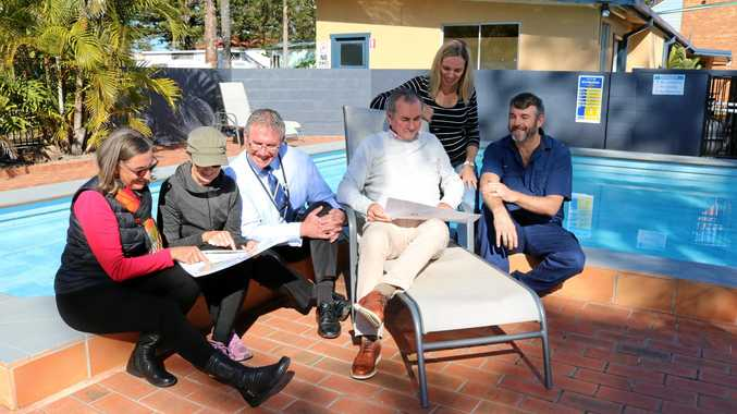 Mr Gulaptis and General Manager of Clarence Valley Council Ashley Lindsay are pictured poolside looking over the redevelopment plans with representatives of the Yamba Chamber of Commerce and Yamba's Calypso Holiday Park Managers, Adrian and Casey Easdown.