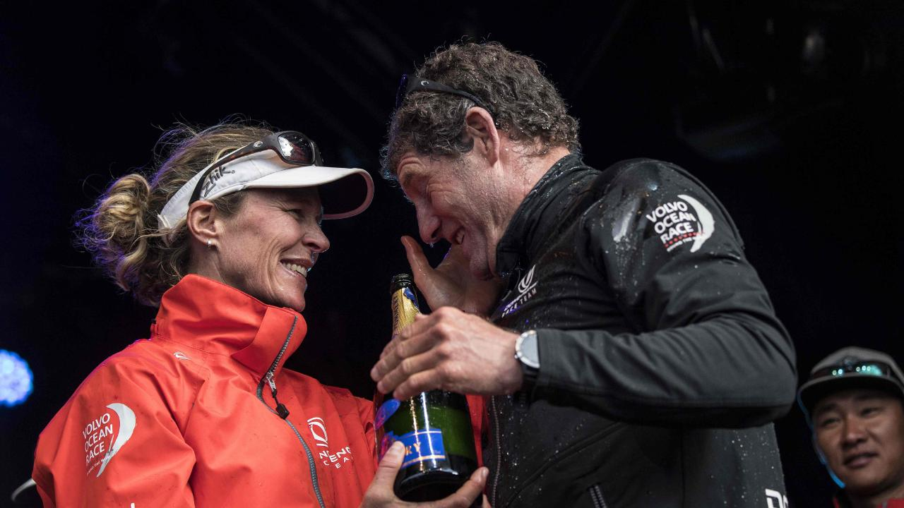 Carolijn Brouwer and skipper Charles Caudrelier celebrate their Volvo Ocean Race win. AFP PHOTO / Christophe ARCHAMBAULT