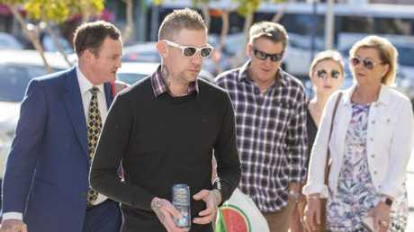 David Turner (second from left), husband of victim Kate Goodchild is seen arriving at the inquest into the Dreamworld disaster at the Southport Courthouse on the Gold Coast, Friday, June 22, 2018. Cindy Low, Kate Goodchild, her brother Luke Dorsett and his partner Roozi Araghi all died when Dreamworld's Thunder River Rapids ride malfunctioned in October 2016.