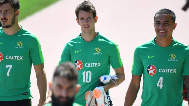 Australia's Mathew Leckie, Robbie Kruse and Tim Cahill arrive for a training session in Kazan. (AAP Image/Dean Lewins)