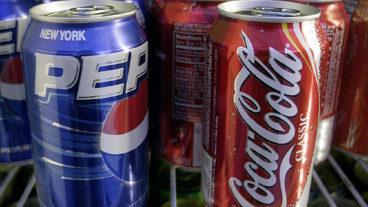 The pledge applies to carbonated soft drinks, energy drinks, sports and electrolyte drinks, frozen drinks, bottled and packaged waters, juice and fruit drinks, cordials, iced teas, ready-to-drink coffees, flavoured milk products and flavoured plant milks. Picture: AP Photo/Mark Lennihan