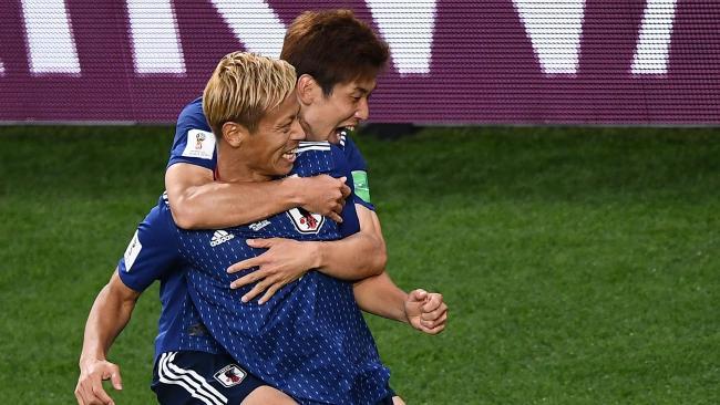 Japan's midfielder Keisuke Honda (R) celebrates his goal with teammate Yuya Osako. (Photo: AFP, Anne-Christine POUJOULAT)