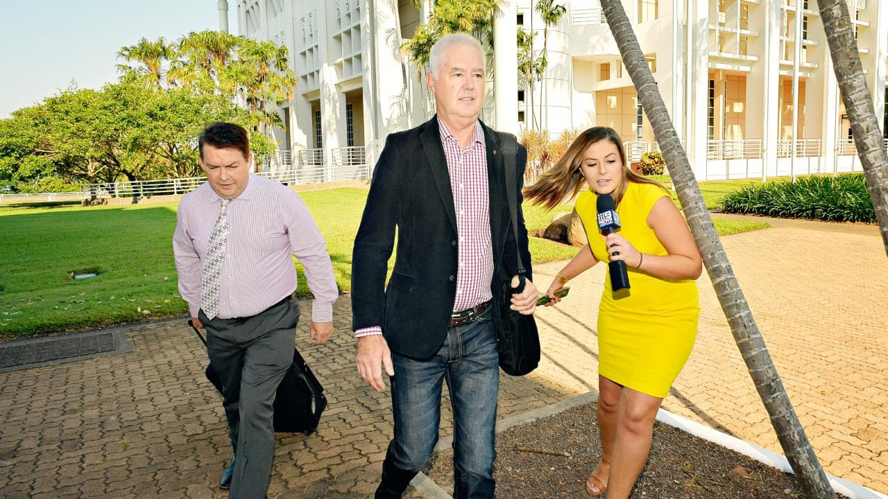 Lawyer Anthony Elliott, left,  and former NT Police Commissioner John McRoberts arrive at the Supreme Court on Monday