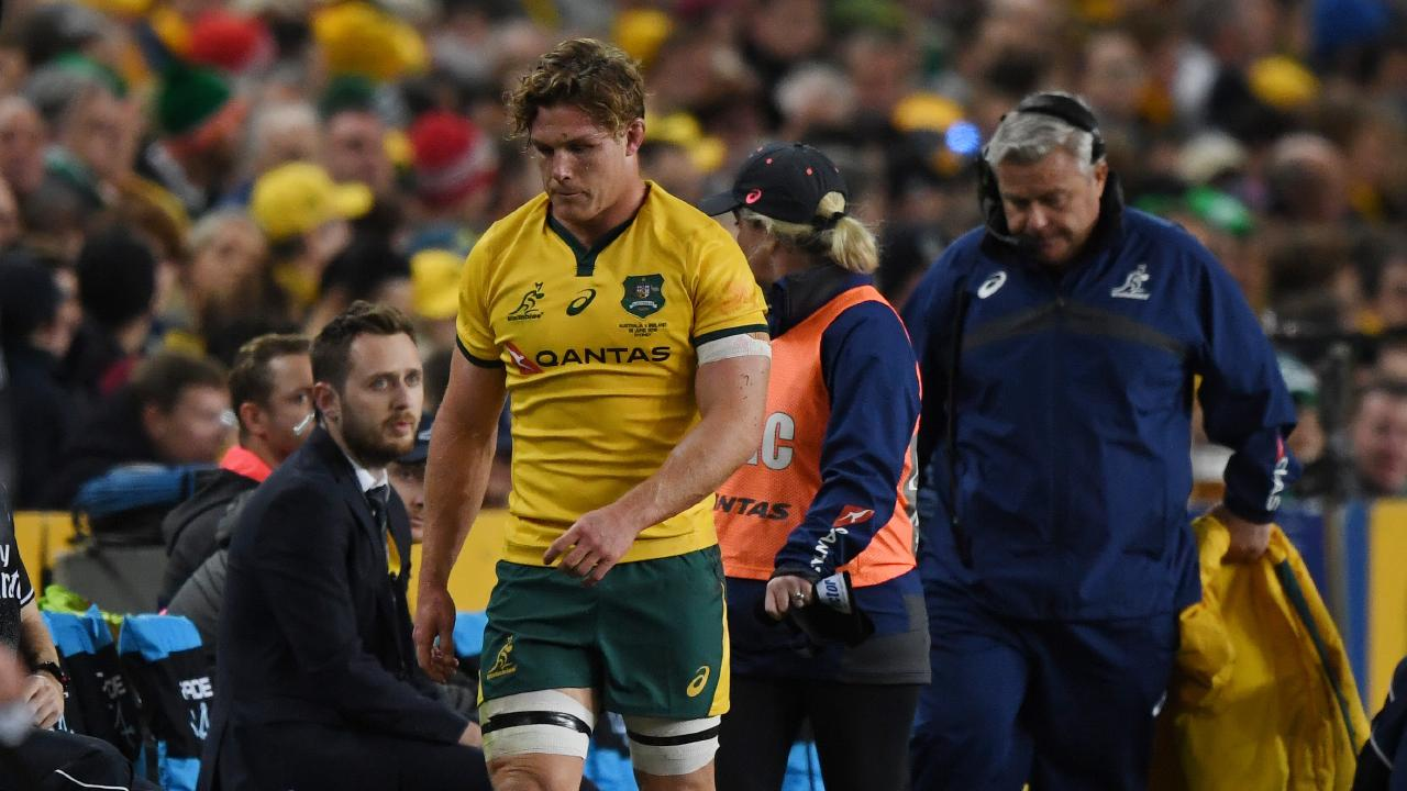 Michael Hooper walks off after being injured in the game against Ireland.
