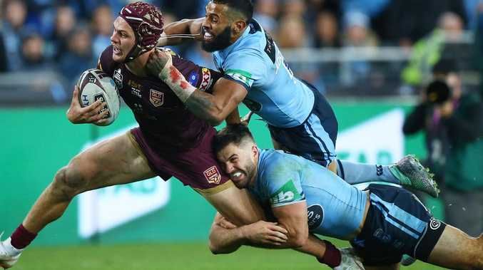 Kalyn Ponga of the Maroons is brought down by James Tedesco and Josh Addo-Carr.