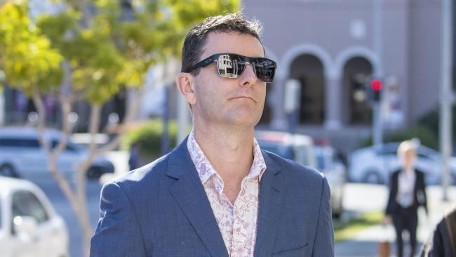 Mathew Low, husband of victim Cindy Low is seen arriving at the inquest into the Dreamworld disaster at the Southport Courthouse on the Gold Coast, Friday, June 22, 2018. Cindy Low, Kate Goodchild, her brother Luke Dorsett and his partner Roozi Araghi all died when Dreamworld's Thunder River Rapids ride malfunctioned in October 2016.