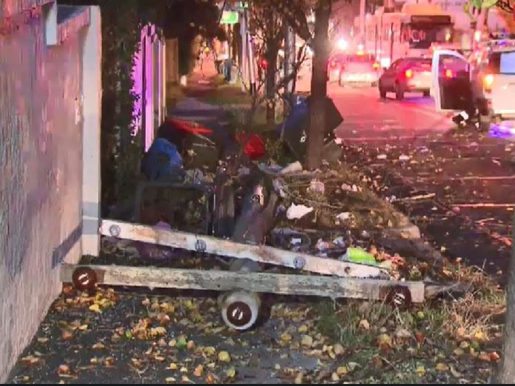 Debris on Toorak Rd after a truck allegedly brought down power lines. Picture: Nine News