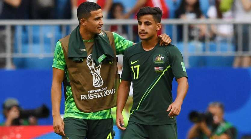 Tim Cahill and Daniel Arzani get ready for a training run. Picture: Getty Images
