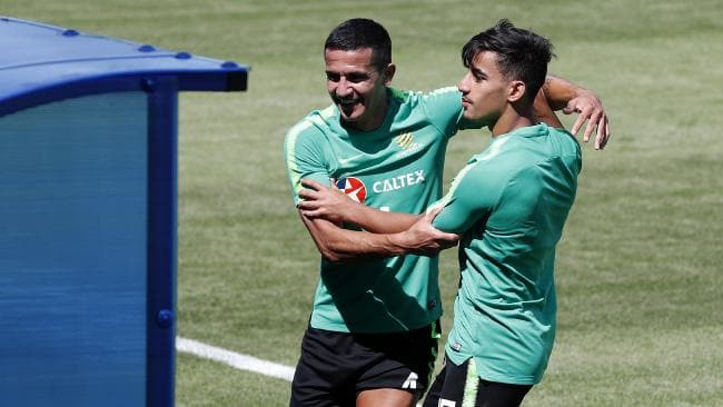 Tim Cahill and Daniel Arzani show off the relaxed nature of the Socceroos camp. Picture: Toby Zerna