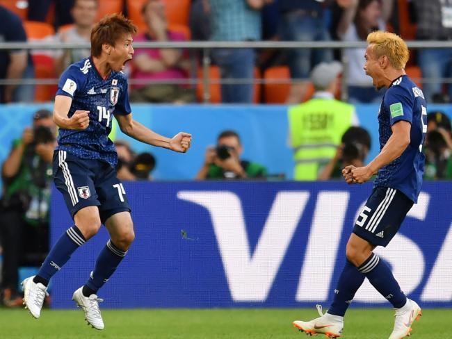 Japan's midfielder Takashi Inui (L) celebrates after scoring against Senegal. PIc: AFP