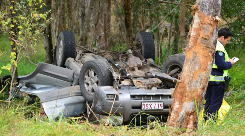 Emergency services are working to free two people trapped in the wreckage of a serious crash on the Sunshine Coast.