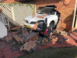 Car smashes through Banora Point home