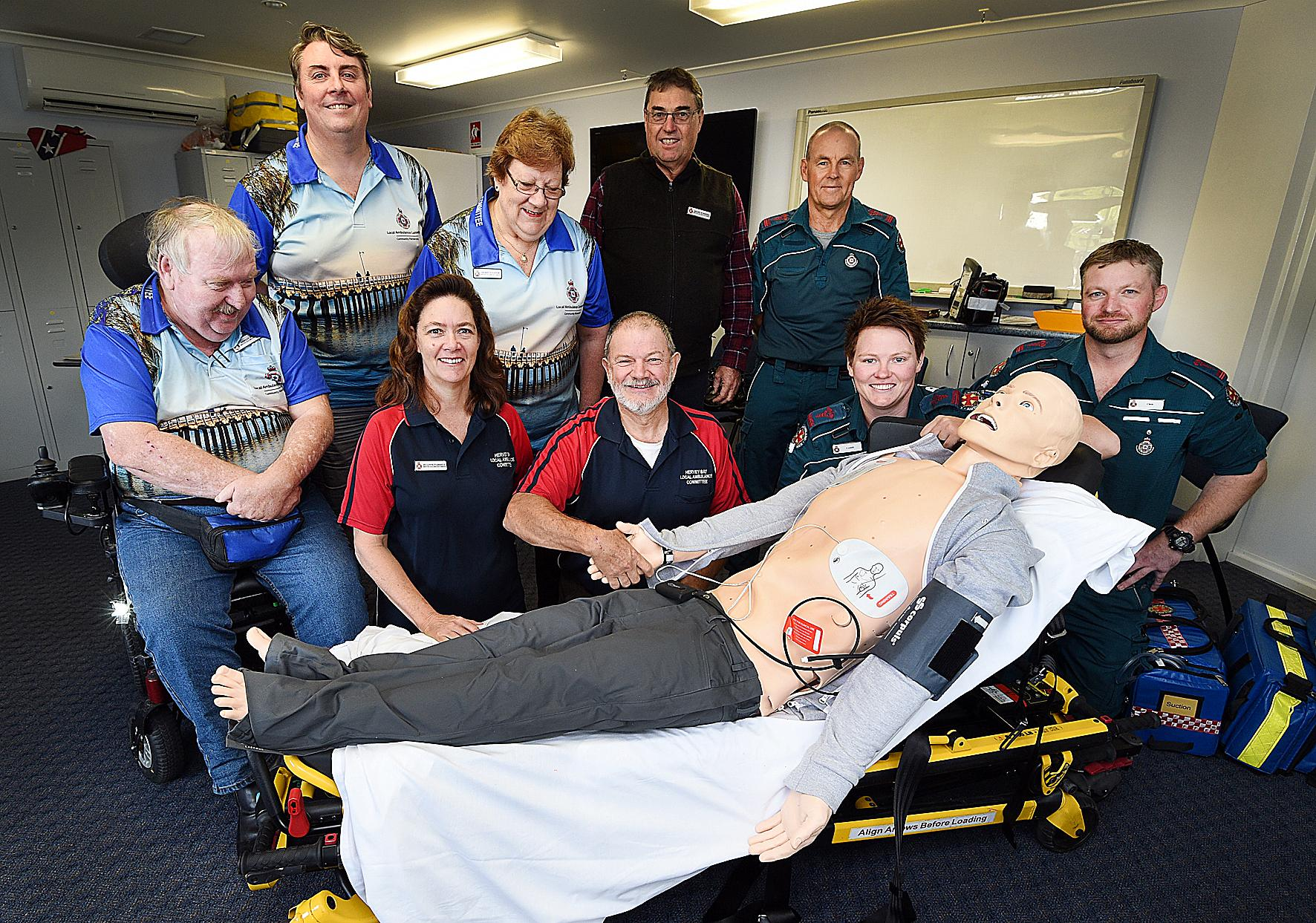 Hervey Bay Local Ambulance Committee with their new mannequin Kev - Front (L) Adrian Doyle, Jo-Anne and Ian Farrell, Cassie Taylor and Chris Giltrap. Back (L) Wayne Frecklington, Merryn Napier, Shane Schiffke and Mark Black.