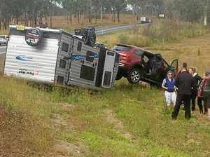 Caravan flips on the Bruce Highway