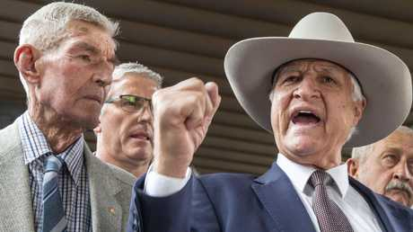 Federal MP Bob Katter, pictured with farmer Charlie Phillott (left), interrupted the banking royal commission with an outburst today. Picture: AAP Image/Glenn Hunt