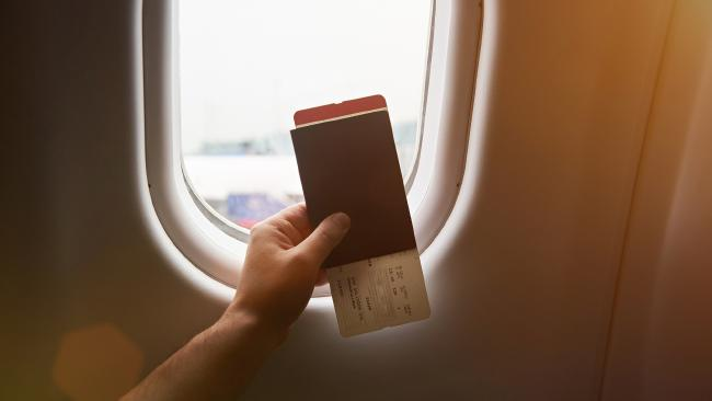 Flight attendants check your boarding pass to make sure you're on the right flight.